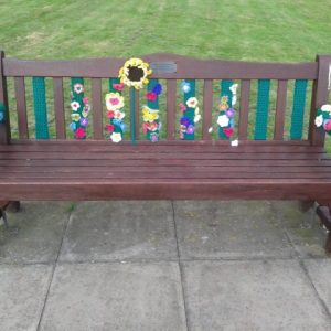 Yarn Bombing on a Village Bench