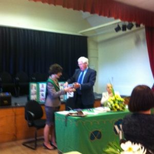 Chairman of the Parish Council Gareth Jones presents the Golden Jubilee Award to Irene Moran